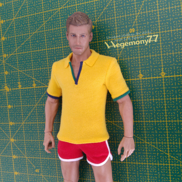 One sixth scale Forrest Gump inspired retro running clothing set - yellow polo shirt and red running shorts - on 12 inch collectible posable action figure on a green cutting mat.jpg